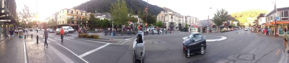 Pan 1 of Queenstown Main Street, on the very right is the Fergburger crowd