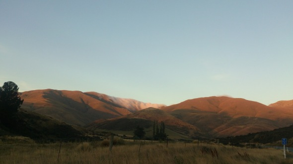 Central Otago - with the clouds somehow hugging that mountain in the middle